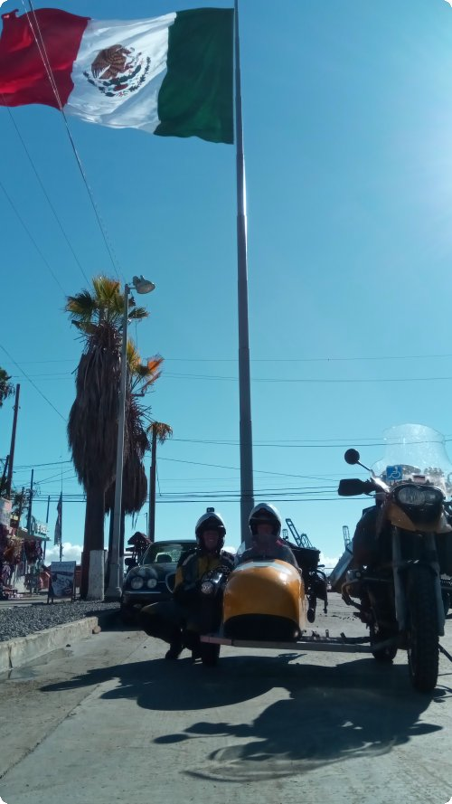 Small motorcycle, big flag: Welcome to Mexico!